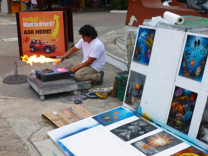 A guy drying his spray paint painting