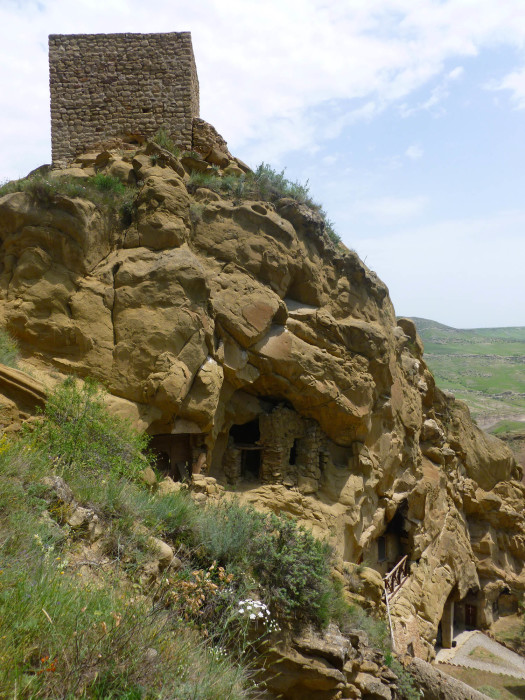 A tower and another ancient monk's cave.