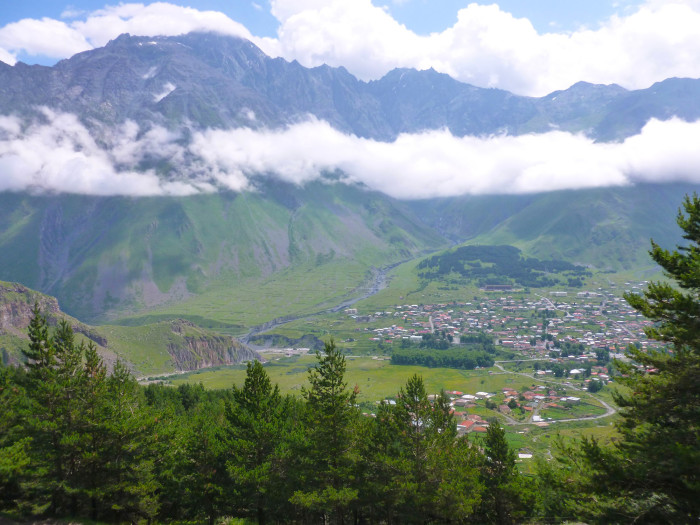 Looking down at Kazbegi from partway up the hike to the church.