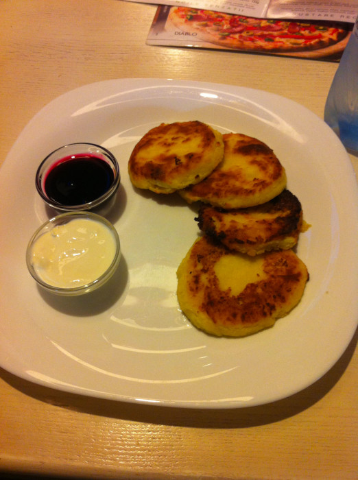 Syrniki. They're little fried sweet cheese pancakes, and they're delicious.