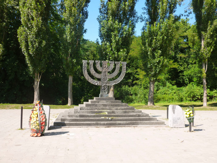 A menorah commemorating the 30,000+ Jews killed in two days at Babi Yar, a ravine in Kiev. The ravine is directly behind the menorah.