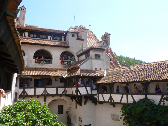 Part of the inside of Bran Castle. Lots of people.