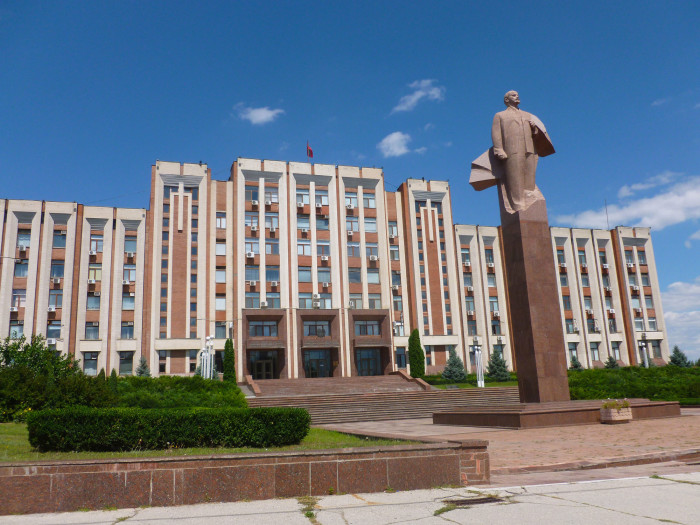 A statue of Lenin in front of a government building