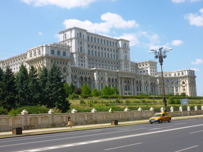 Palace of the Parliament in Bucharest. This is the world's largest civilian building with an administrative function, the most expensive administrative building, and the heaviest building. Construction was started on Ceauşescu's orders in 1983 and it wasn't completed until 1997. A big chunk of Bucharest's historical district was leveled and some 50,000 displaced in order to build the building.
