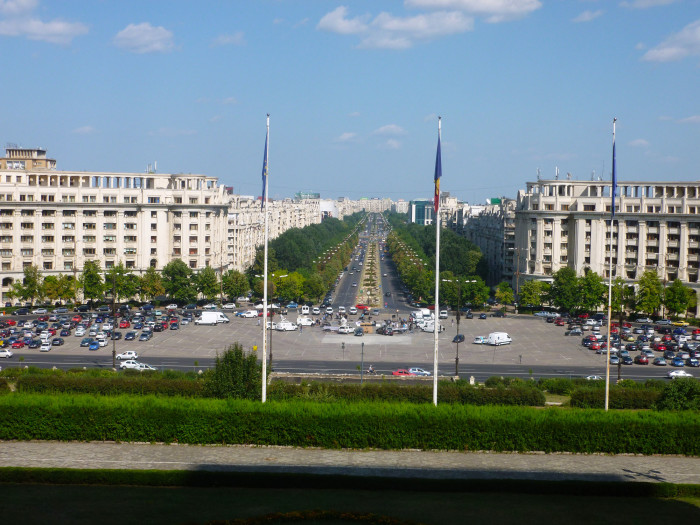 "Looking down Bucharest's version of the Champs Elysees, the Bulevardul Unirii. According to Wikipedia, ""the road is lined with socialist-realist apartment blocks of North Korean inspiration."""