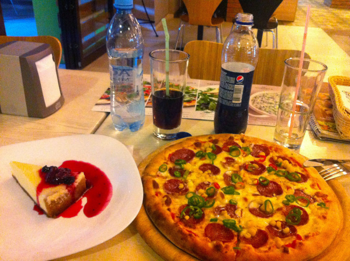 American food: pizza (with corn) and cheesecake