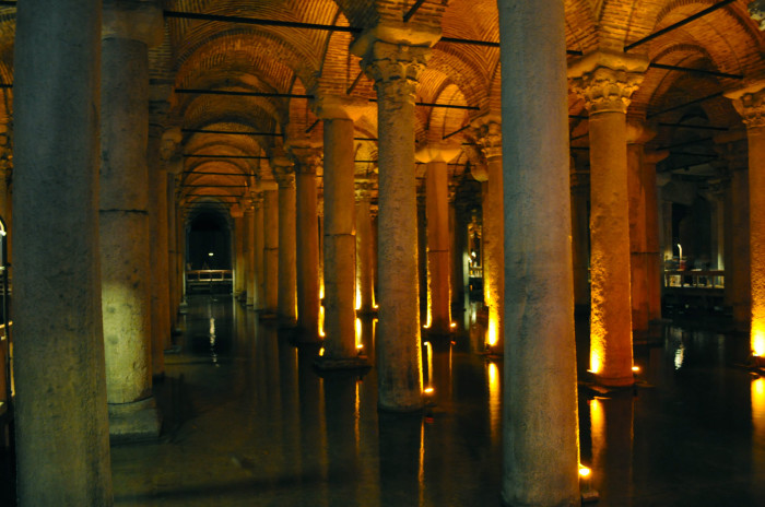 """Inside the amazing Basilica Cistern. It was built in the 6th century and was rediscovered in the 16th. Here's an excerpt from Lonely Planet: """"""""It seemed to have been forgotten by the city authorities sometime before the Conquest. Enter scholar Petrus Gyllius, who was researching Byzantine antiquities in 1545 and was told by locals that they could obtain water by lowering buckets in their basement floors. Some were even catching fish this way. Intrigued, Gyllius explored the neighbourhood and discovered a house through whose basement he accessed the cistern. Even after his discovery, the Ottomans (who referred to the cistern as Yerebatan Sarayı) didn't treat the underground palace with the respect it deserved and it became a dumping ground for all sorts of junk, as well as corpses."""""""