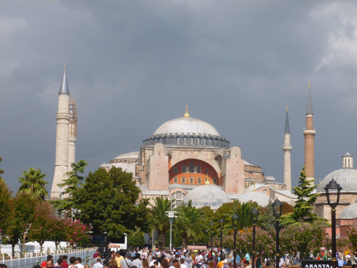 """The famous Hagia Sophia, one of the more imposing religious structures I've ever seen. It played a huge role in the conversion of the Kievan Rus (the ancestors of modern Russians and Ukrainans) to Christianity. This is from Wikipedia: """"In the year 987, as the result of a consultation with his boyars, Vladimir sent envoys to study the religions of the various neighboring nations whose representatives had been urging him to embrace their respective faiths. Of the Muslim Bulgarians of the Volga the envoys reported there is no joy among them; only sorrow and a great stench. In the gloomy churches of the Germans his emissaries saw no beauty; but at Hagia Sophia, where the full festival ritual of the Byzantine Church was set in motion to impress them, they found their ideal: """"We no longer knew whether we were in heaven or on earth,"""" they reported, """"nor such beauty, and we know not how to tell of it."""""""""""