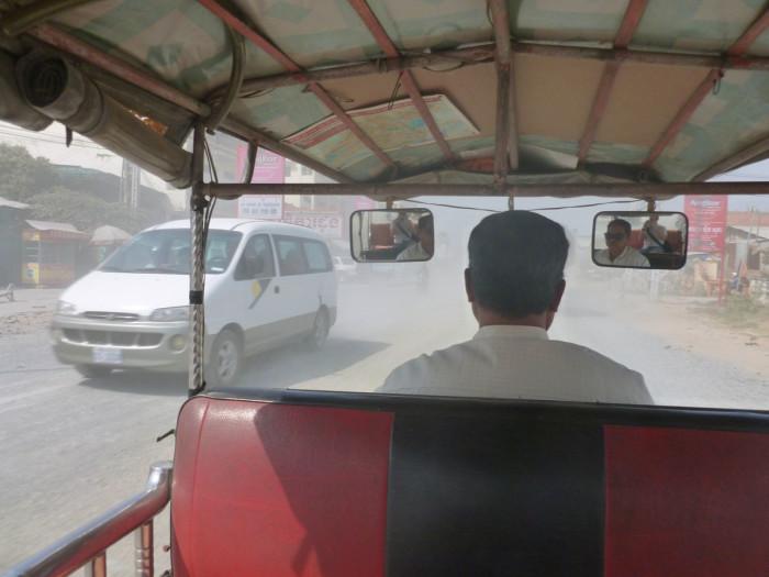 Riding in a tuk tuk. Look how freaking dusty it is!