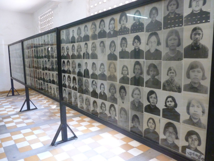 """Prisoners were photographed when they were taken to the prison. Nearly all of them were killed. According to Wikipedia: """"Out of an estimated 17,000 people imprisoned at Tuol Sleng, there were only twelve known survivors."""""""