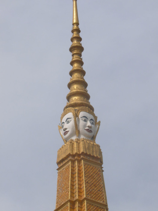 Faces on one of the spires inside the Royal Palace