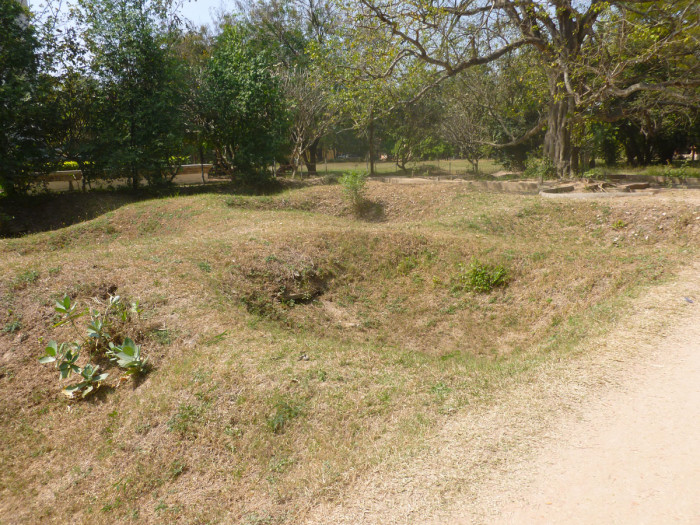 The depressions in the ground are graves that have been excavated.