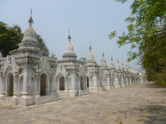"""Some of the stupas of Kuthodaw Temple. Each stupa contains a tablet with writing in it. Together, they make up """"the world's largest book."""""""