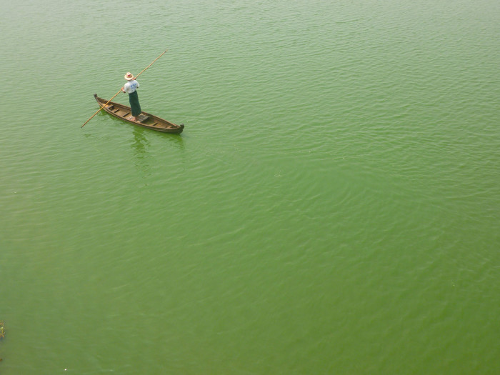 A guy on a boat in the lake