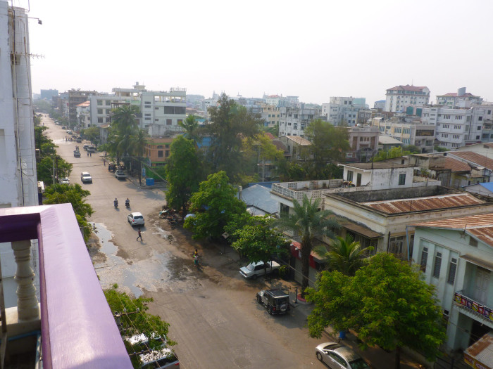 Looking out from the hotel onto a street in Mandalay