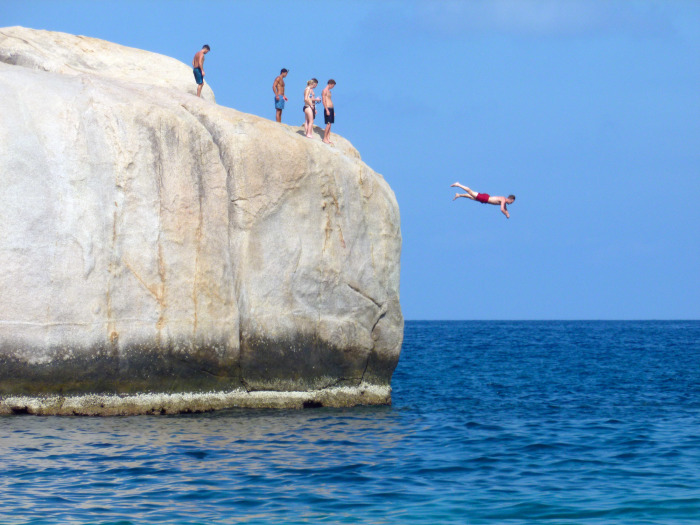 A guy diving off a rock at Tanote Bay, Koh Tao. I jumped off of this cliff, but definitely didn't dive off of it.