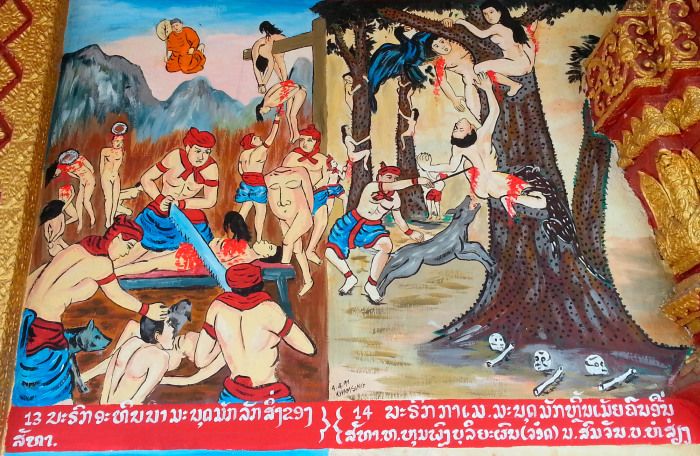 Scenes from some sort of Buddhist hellscape on the side of a temple in Luang Prabang, Laos.