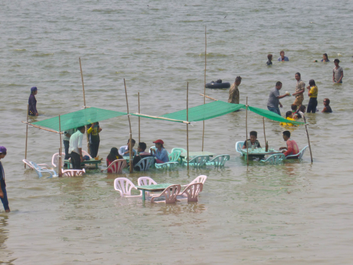 I saw people eating in a lake in Myanmar